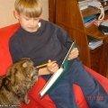 Ксюшенька помогает маленькому хозяину делать уроки